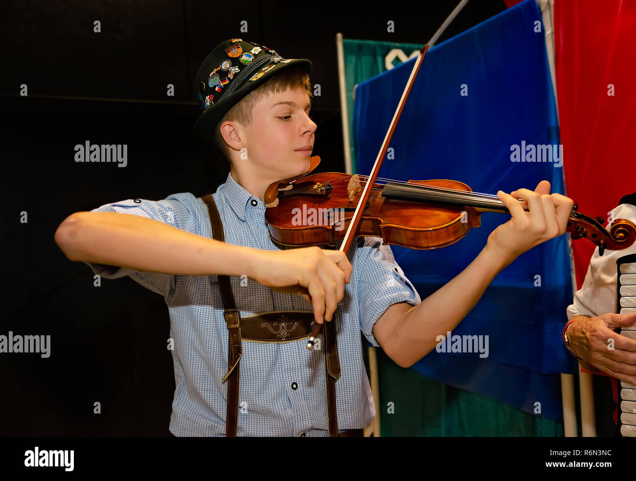 A young musician plays violin at the 34th annual Mobile International Festival, Nov. 17, 2018, in Mobile, Alabama. - Stock Image