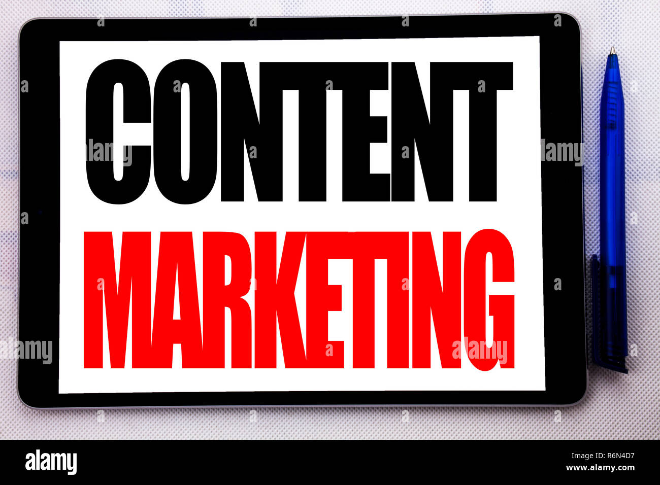 Conceptual hand writing text caption inspiration showing Content Marketing. Business concept for Online Media Plan written on tablet computer on the white background with pen in the office. Stock Photo