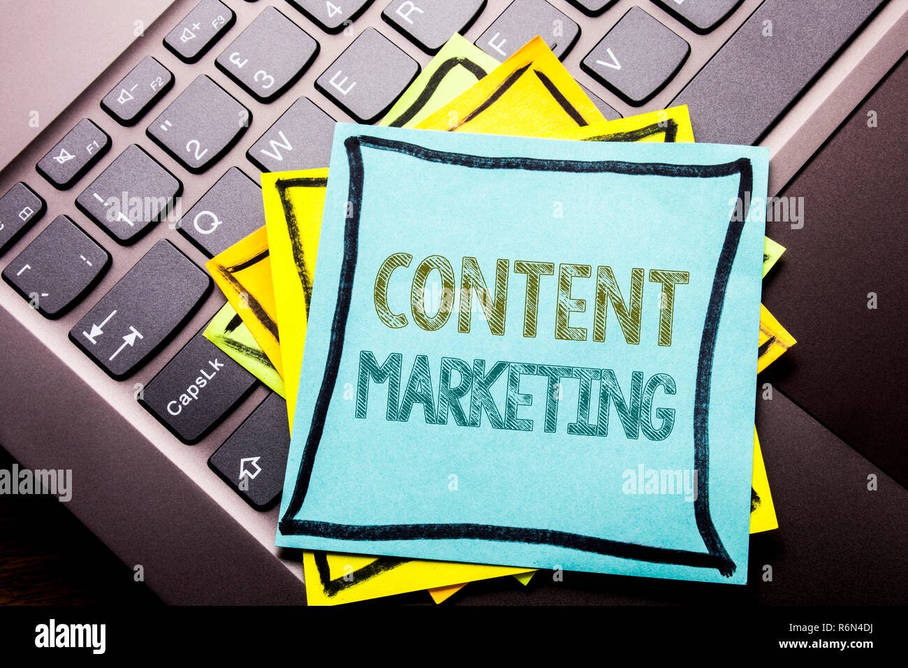 Conceptual hand writing text caption inspiration showing Content Marketing. Business concept for Online Media Plan written on sticky note paper on the dark keyboard background. Stock Photo