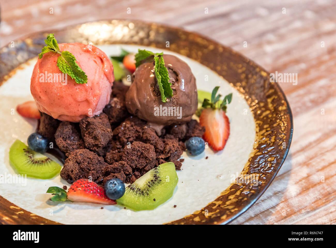 Chocolate brownie with gelato Stock Photo
