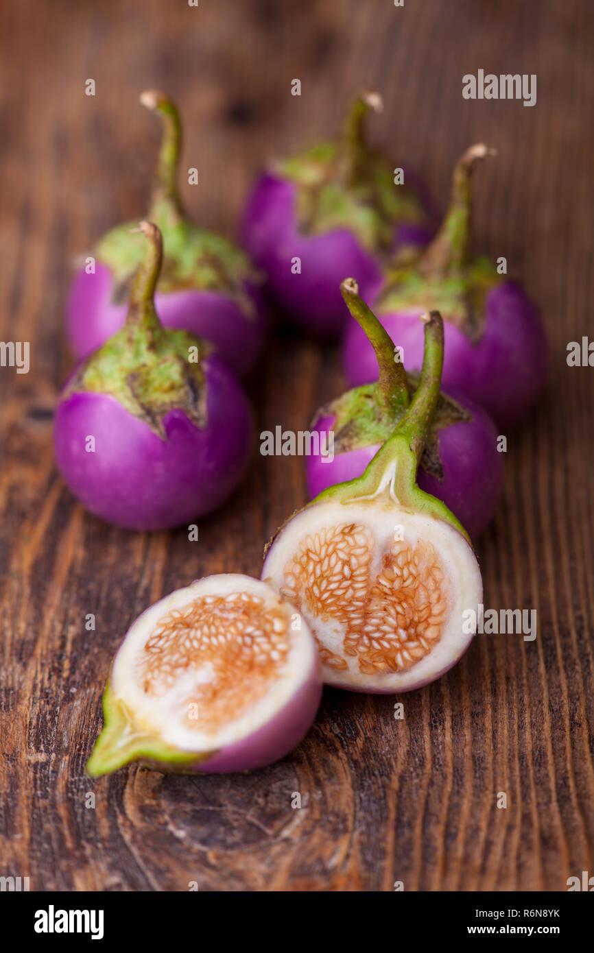 asian eggplants on dark wood Stock Photo