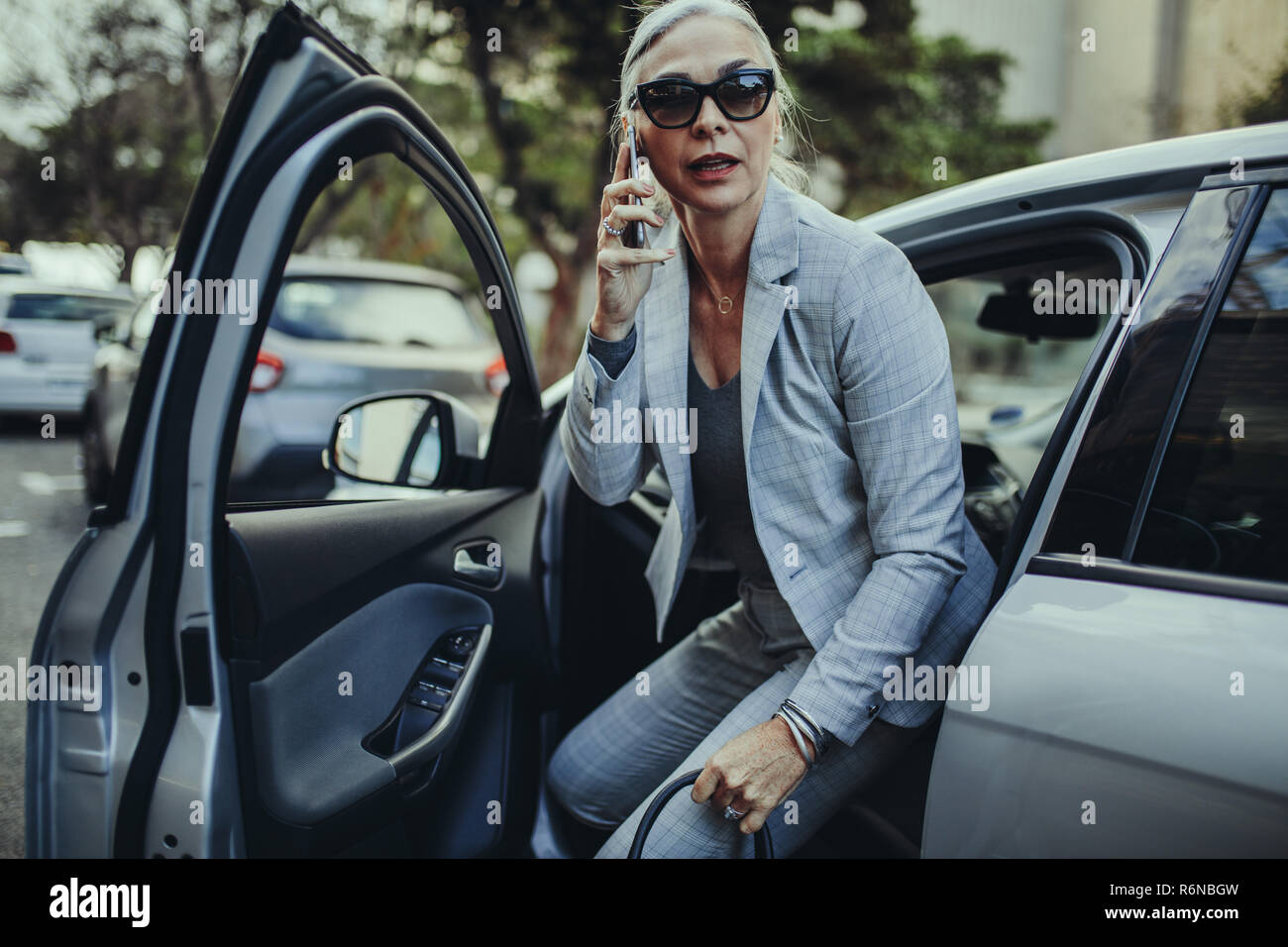 business woman getting out car stock photos business woman getting out car stock images alamy. Black Bedroom Furniture Sets. Home Design Ideas