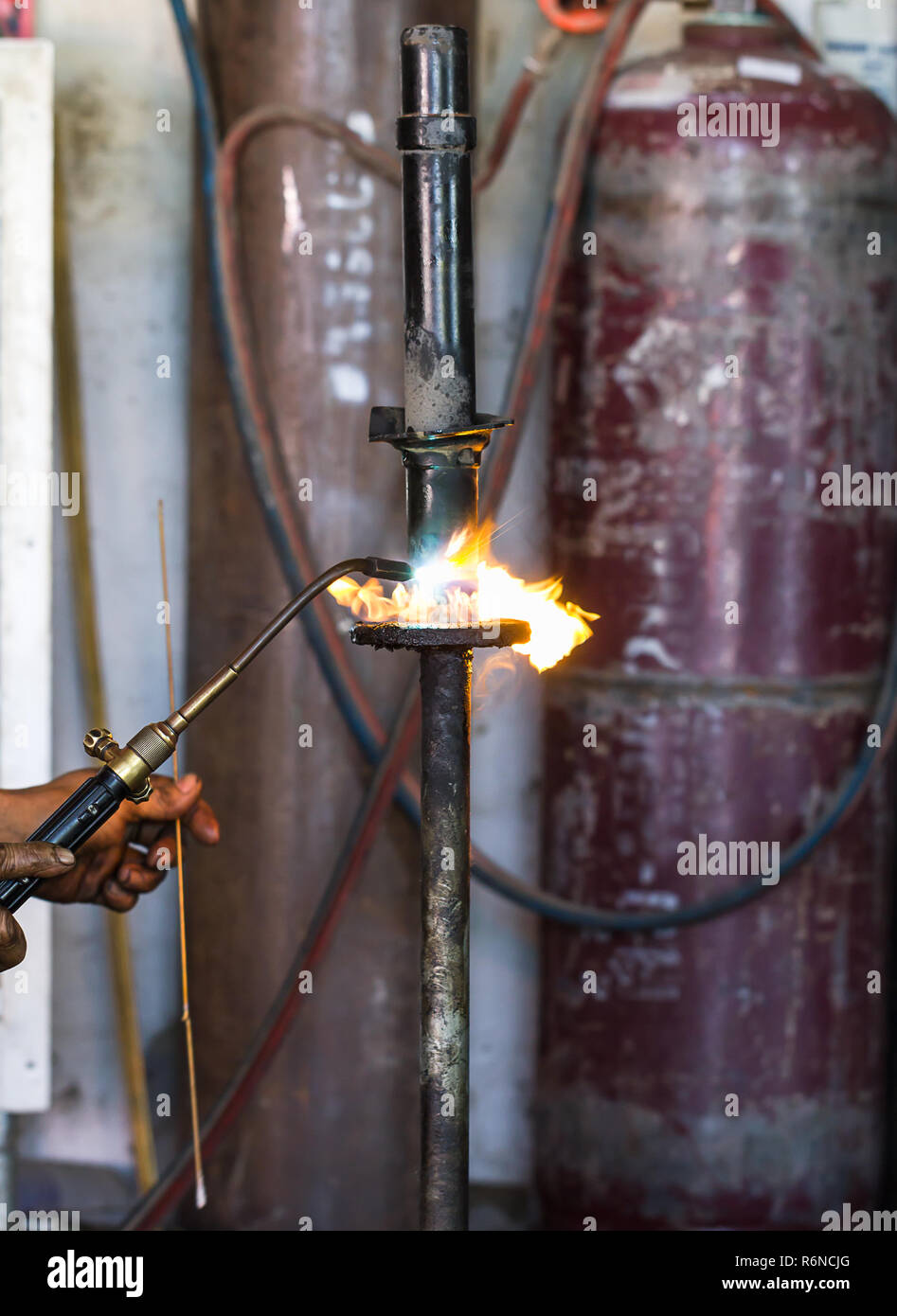Welders were repairing cutting Shock absorbers - Stock Image