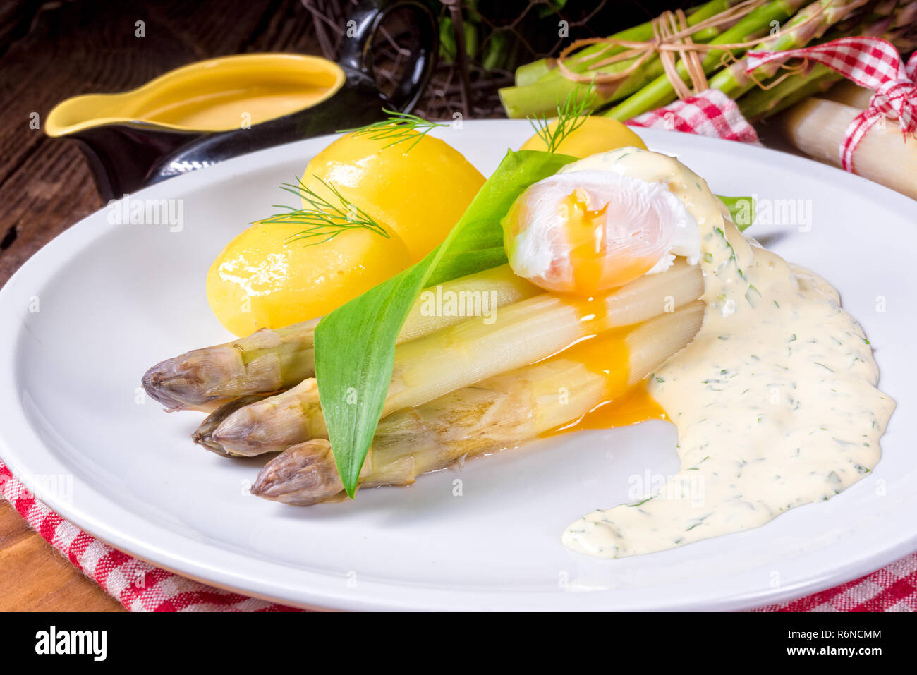 asparagus with egg and fresh wild garlic Stock Photo
