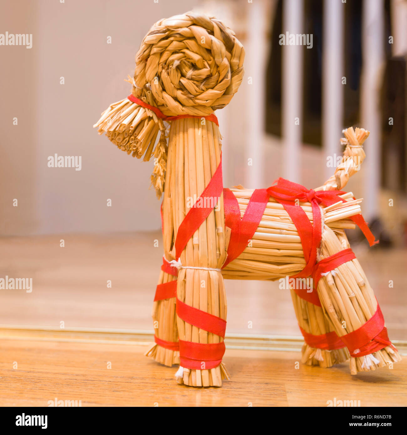 FLODA, SWEDEN - NOVEMBER 28 2018: Close up view of typical Swedish handmade straw Christmas ornament Yule goat decorated with red ribbon - Stock Image