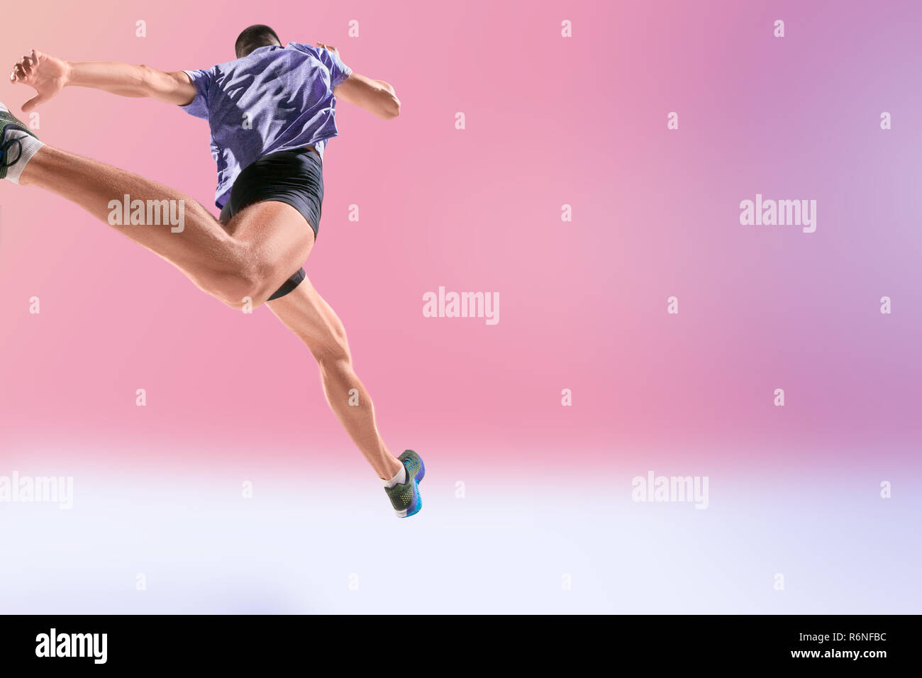 The studio shot of high jump athlete is in action - Stock Image