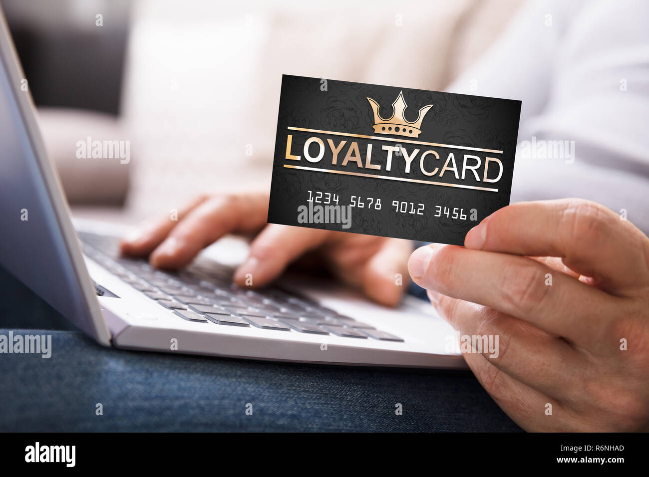 Person With Loyalty Card Using Laptop - Stock Image
