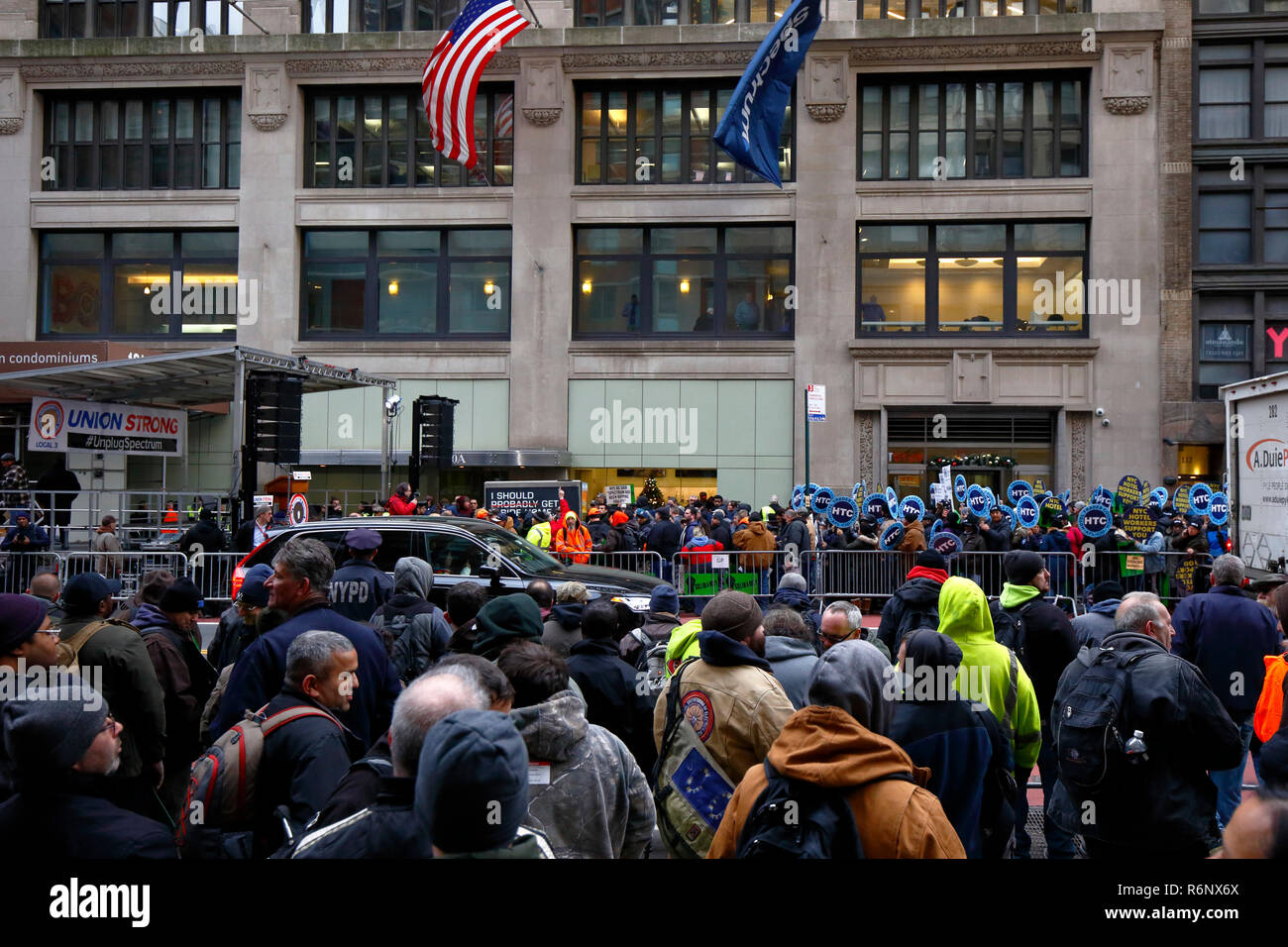 A large union labor rally held outside Charter Spectrum's offices denouncing their union busting, and deceptive business practices - Stock Image
