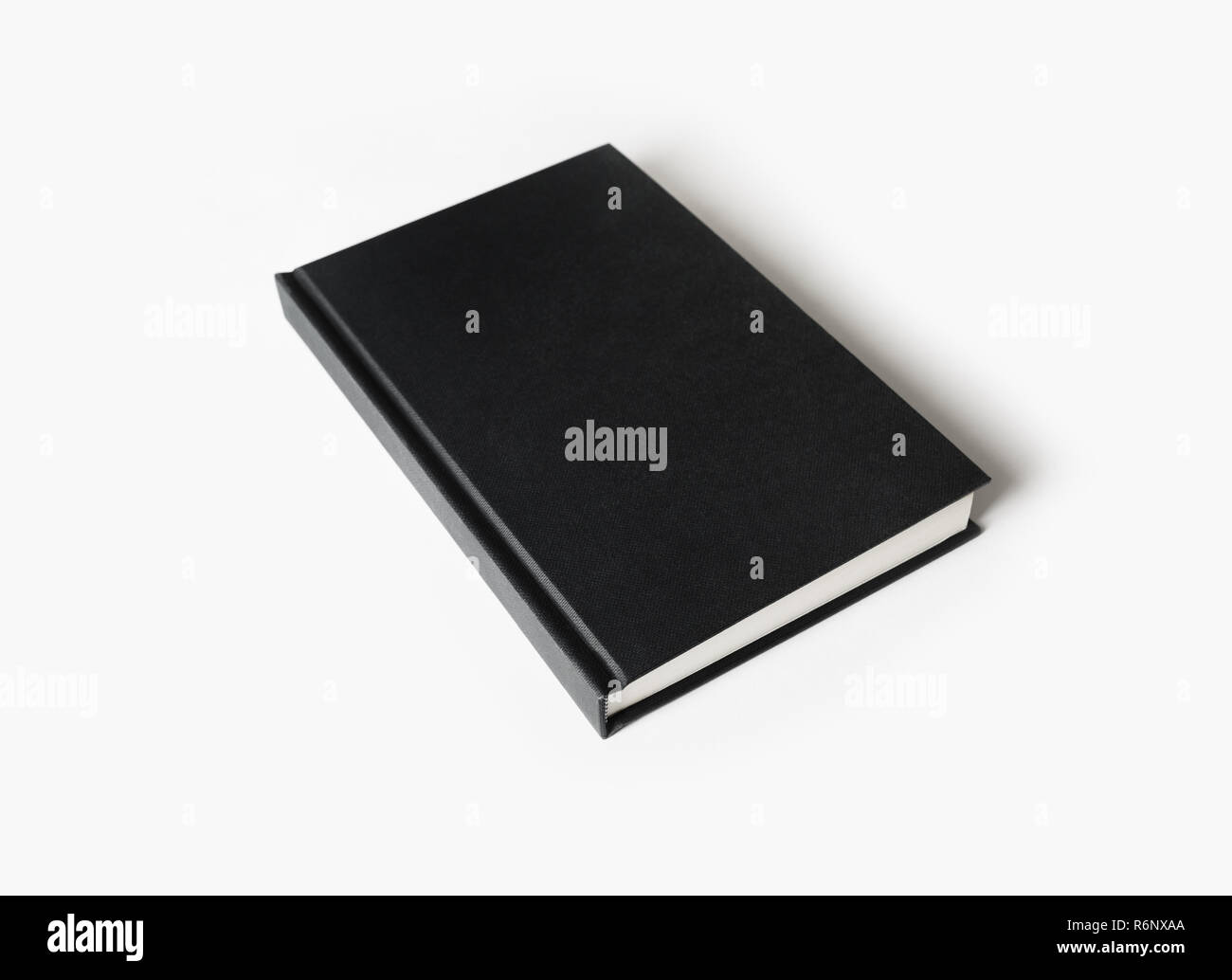 Black hardcover book - Stock Image