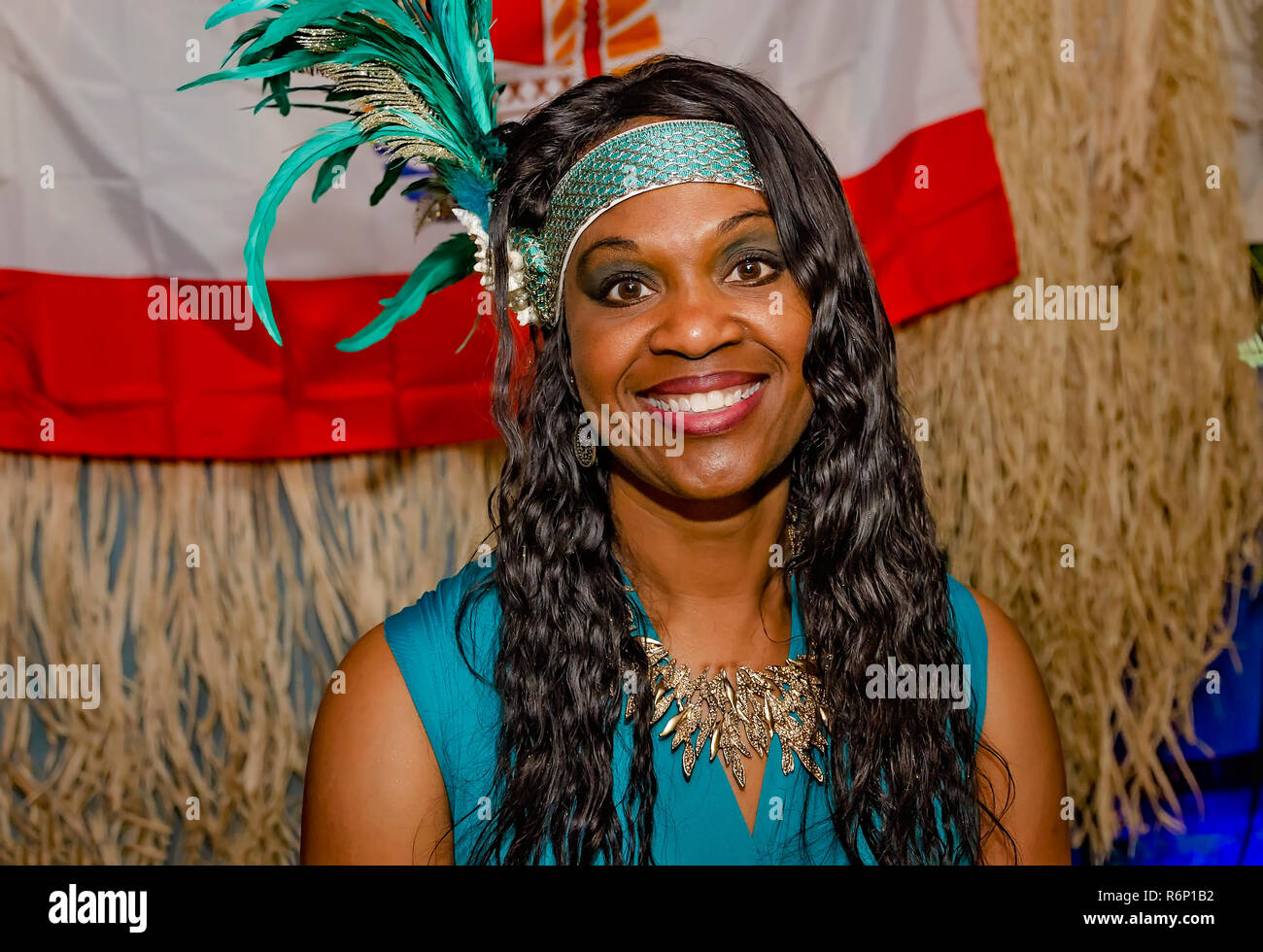 A Polynesian woman wears a Tahitian headdress at the 34th annual Mobile International Festival, Nov. 17, 2018, in Mobile, Alabama. - Stock Image