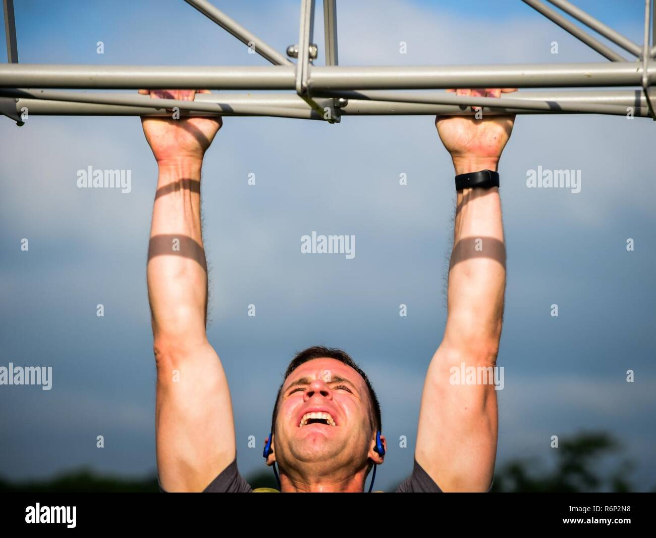 a participant does a pullup during a memorial day murph and