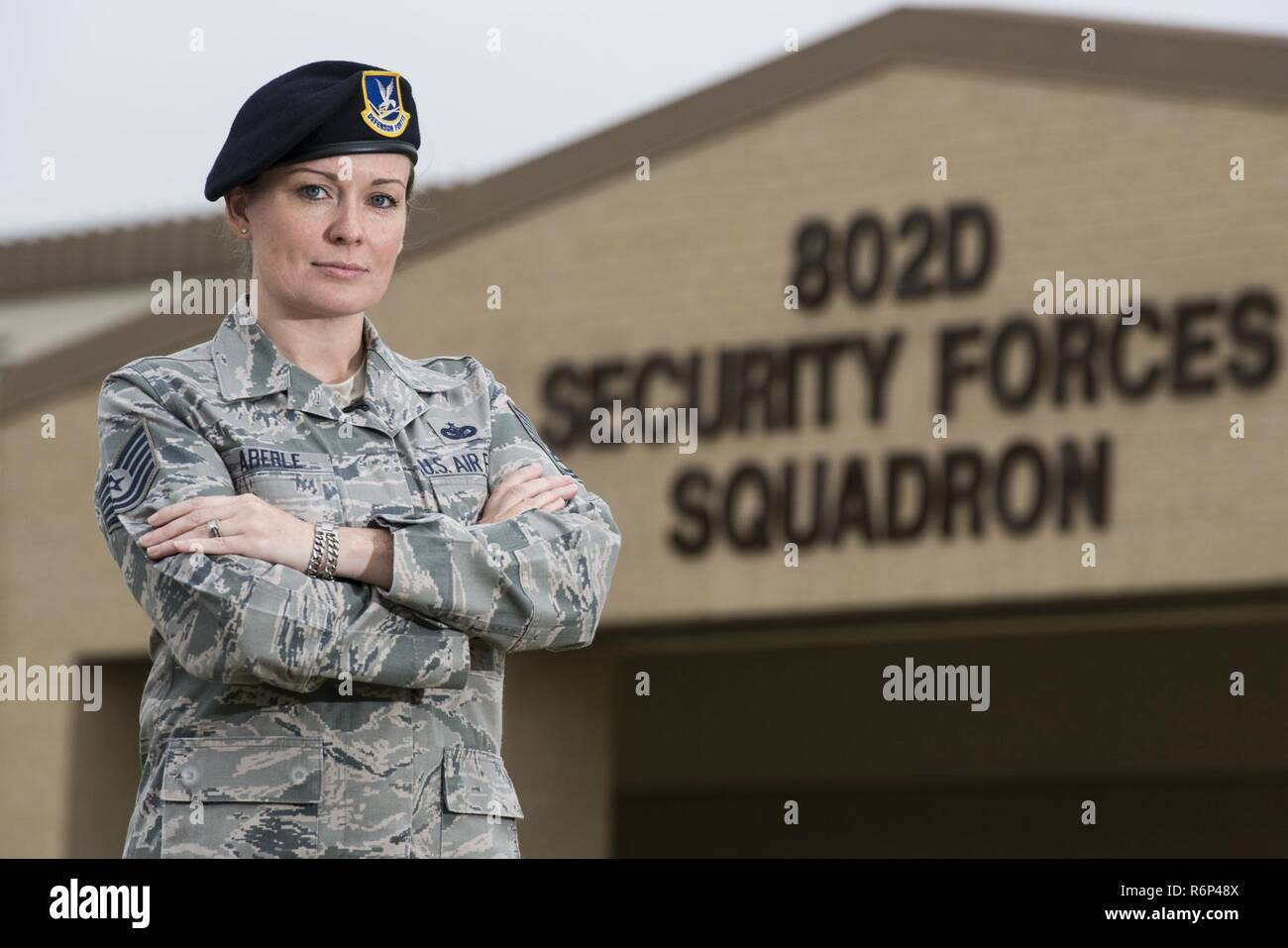 Technical Sgt. Michelle Aberle, 802nd Security Forces Squadron installation security, poses for a photo prior to conducting a security check May 9, 2017, at Joint Base San Antonio-Lackland, Texas.  Aberle and Turner provide force protection for base personnel, equipment and facilities from threats to include intrusion by unauthorized people. - Stock Image