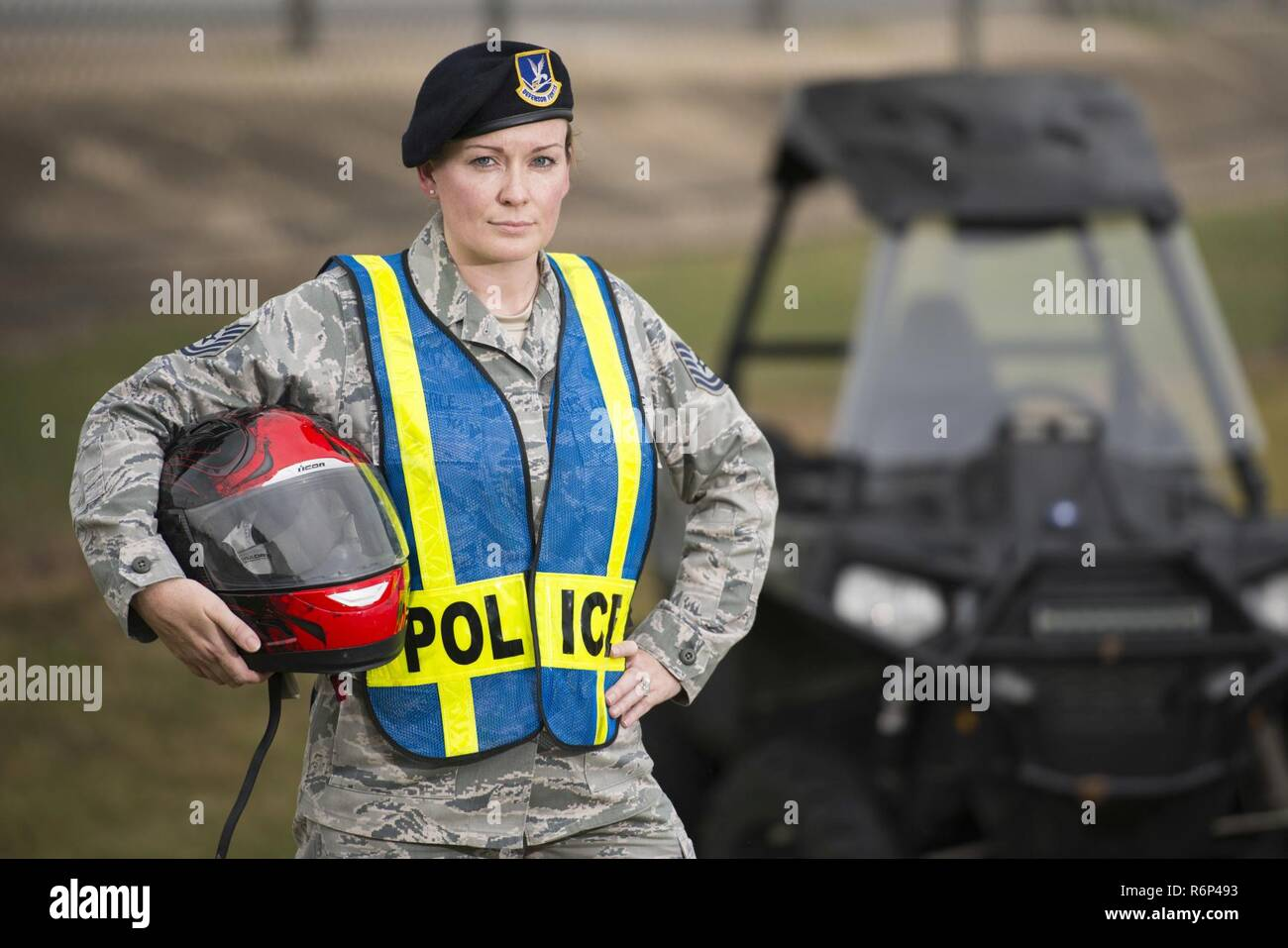 Technical Sgt. Michelle Aberle, 802nd Security Forces Squadron installation security, poses for a photo after conducting a security check on the base fence line May 9, 2017, at Joint Base San Antonio-Lackland, Texas.  Aberle and Turner provide force protection for base personnel, equipment and facilities from threats to include intrusion by unauthorized people. - Stock Image