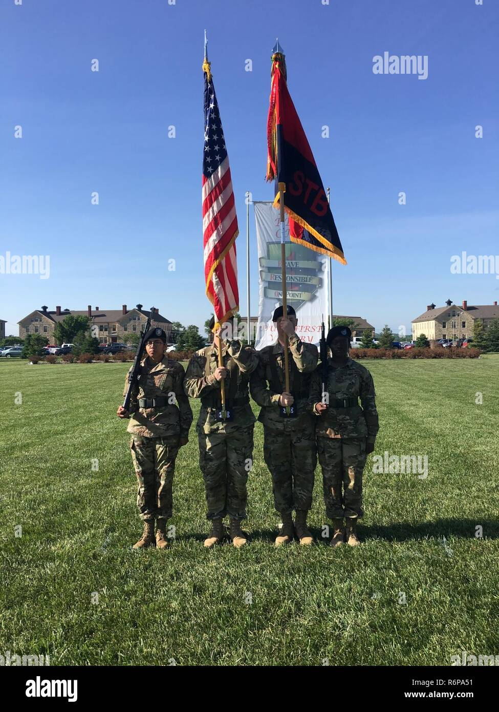 Pfc. Yaa Agyemang (far right), financial clerk 9th Financial Management Sustainment Unit, 1st Infantry Division, Sustainment Brigade, performs her duty as a rifleman of the Honor Guard during a change of command ceremony for Special Troops Battalion, Sustainment Brigade, on May 18, 2017 on Calvary Parade Field at Ft. Riley, KS. Agyemang was hand picked by the unit's Command Sgt. Maj. to perform the duty. ( - Stock Image
