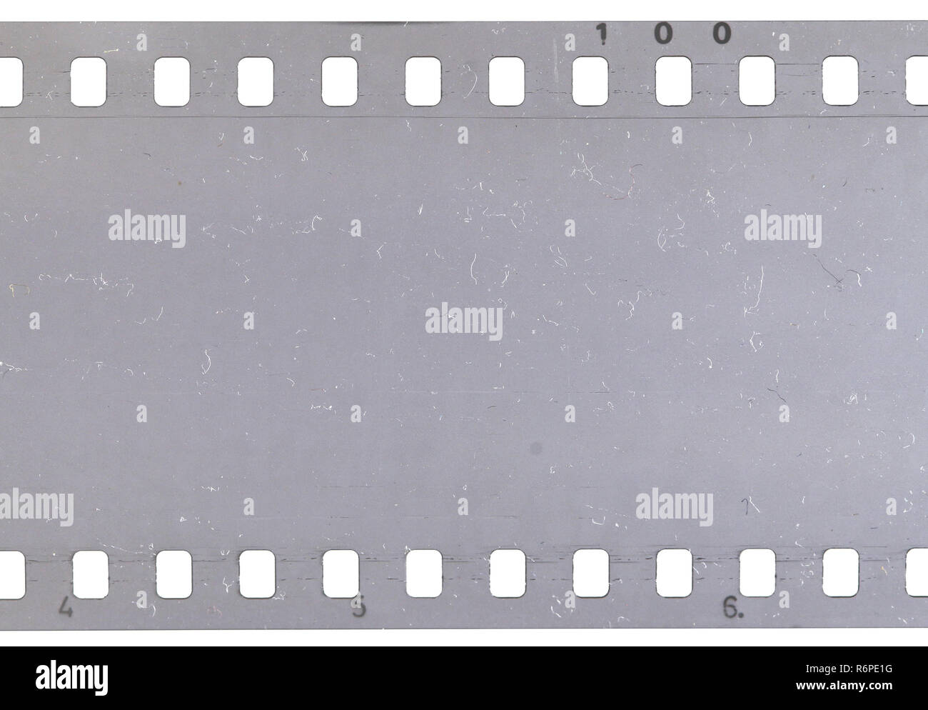 Strip of old celluloid film with dust and scratches Stock Photo