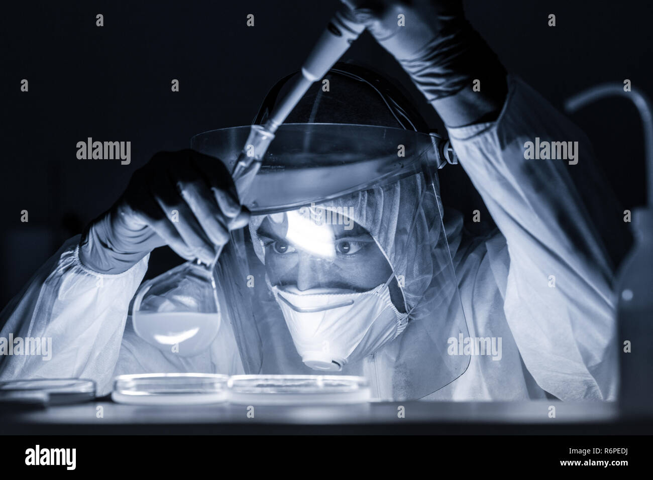 Life scientist researching in bio hazard laboratory. High degree of protection work. Stock Photo