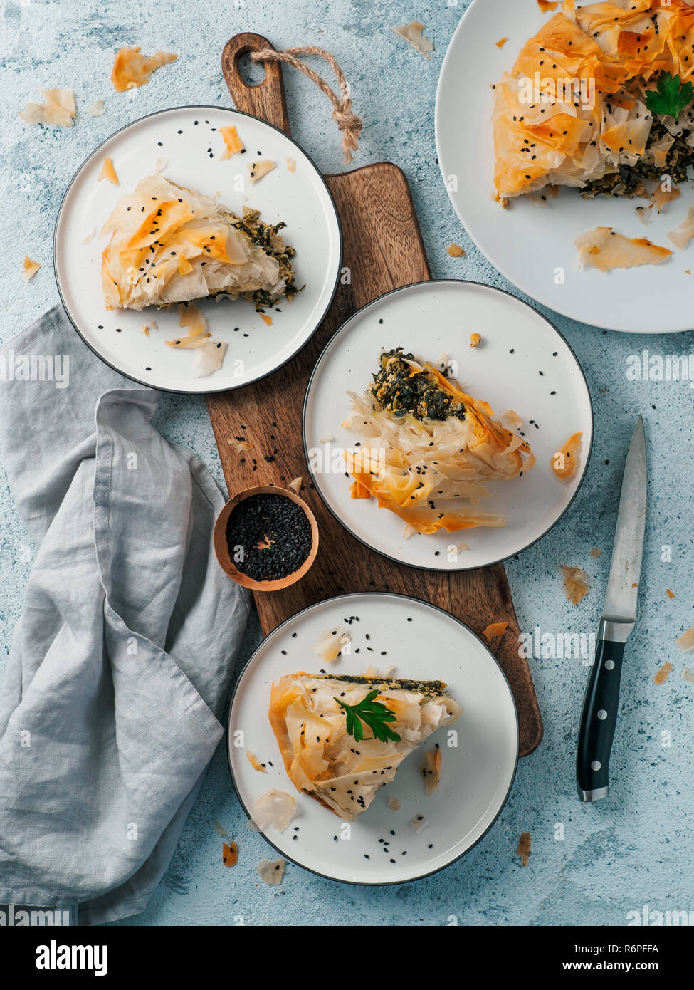Greek Pie Spanakopita On Gray Background Ideas And Recipes For Vegetarian Or Vegan Spanakopita Spinach Pie From Fillo Pastry Slices Pie On Plates Copy Space Top View Or Flat Lay Vertical Stock