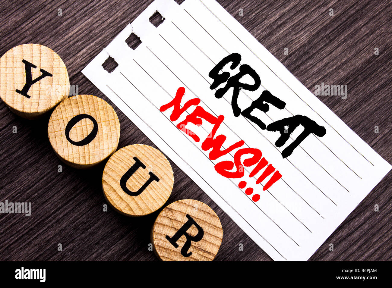 Writing text showing  Great News. Business photo showcasing Success Newspaper Information Celebration written on tear note paper sticky note on the wooden background. Stock Photo