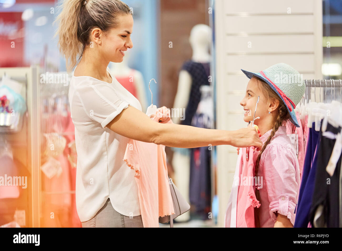 Mother choosing clothes for the daughter in a fashion