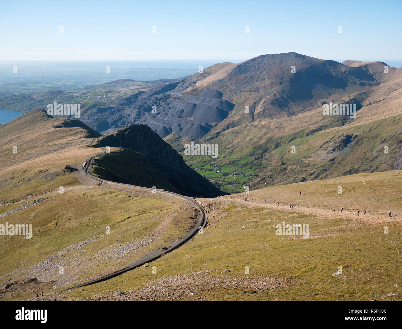 View down Snowdon's north ridge towards Llanberis, showing the Llanberis path, railway, Llechog buttress and the Dinorwig slate works on Elidir Fawr Stock Photo
