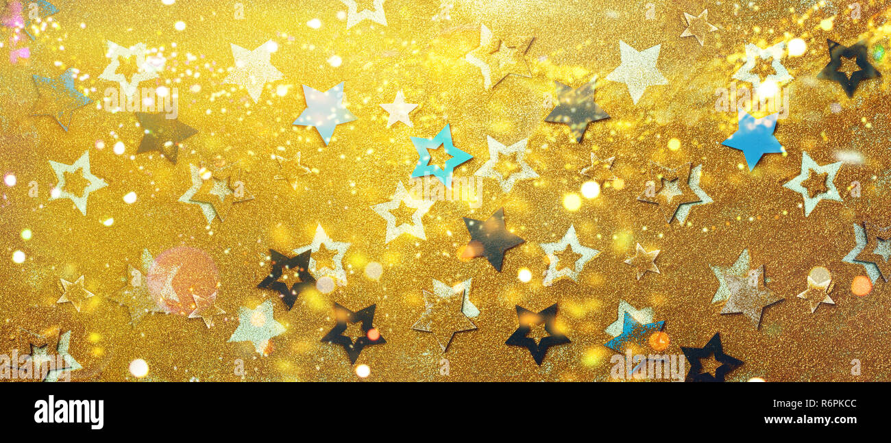 Blue Yellow Stars On Gold Background With Bokeh Texture For New