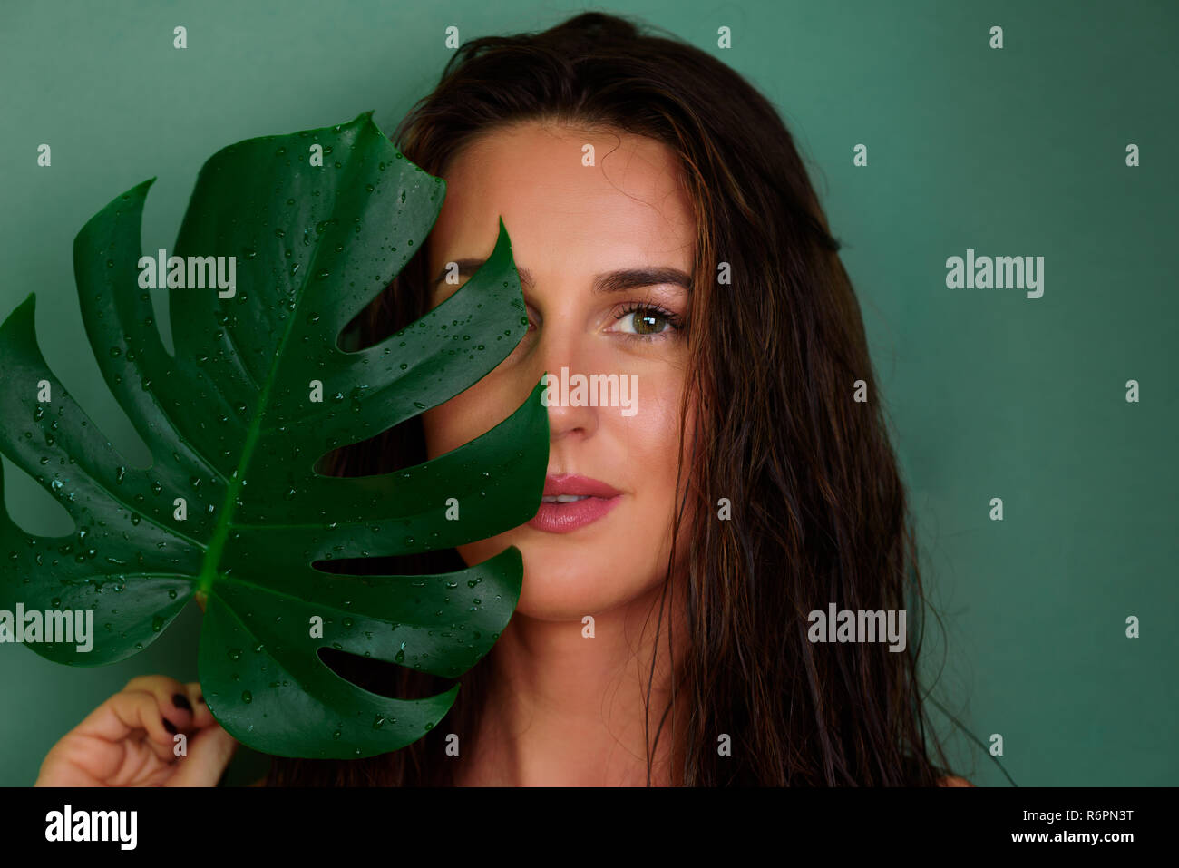 Young Girl With Wet Hair Natural Make Up Holding Tropical Monstera Leaf On Green Background Banner Copy Space Skin Care Pure Beauty Body Treatme Stock Photo Alamy