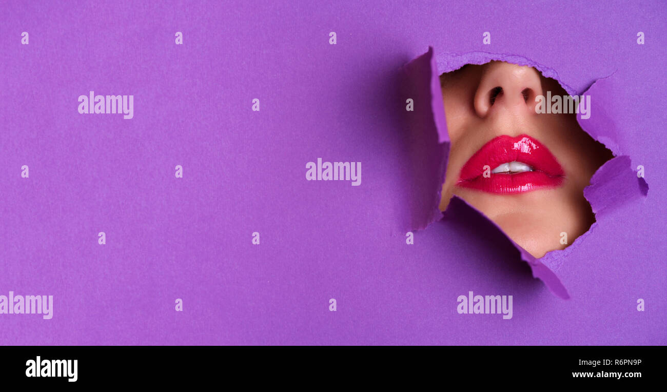 View Of Bright Lips Through Hole In Violet Paper Background Make Up Artist Beauty Concept Cosmetics Sale Beauty Salon Advertising Banner With Copy Stock Photo Alamy