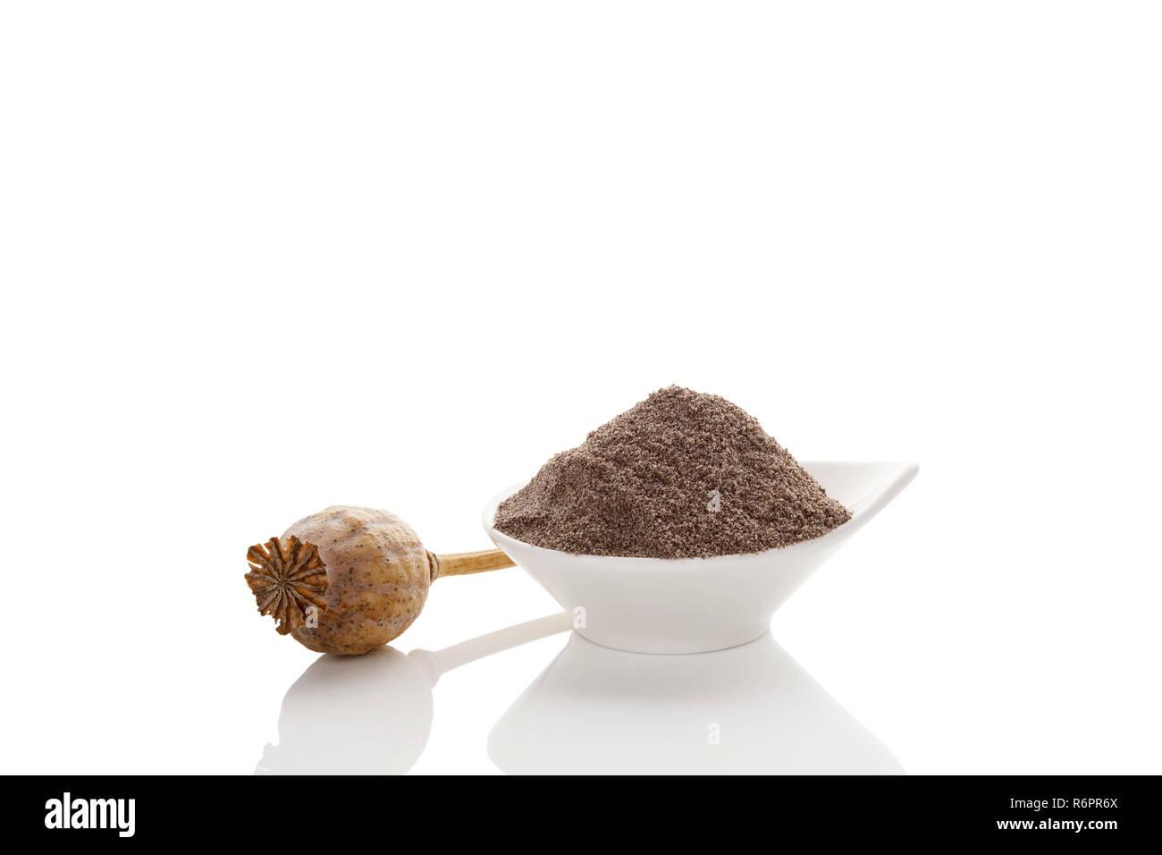 Poppy seeds and dry poppy pod. - Stock Image
