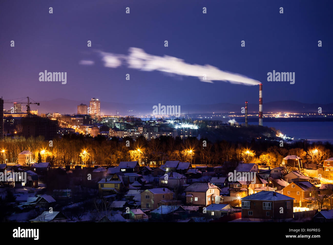 Night view to city outback in winter. Khabarovsk, Russia - Stock Image