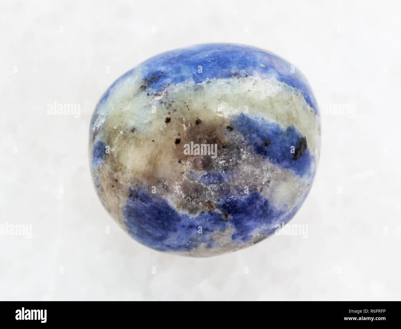 Polished Sodalite Gem Stone On White Marble Stock Photo Alamy