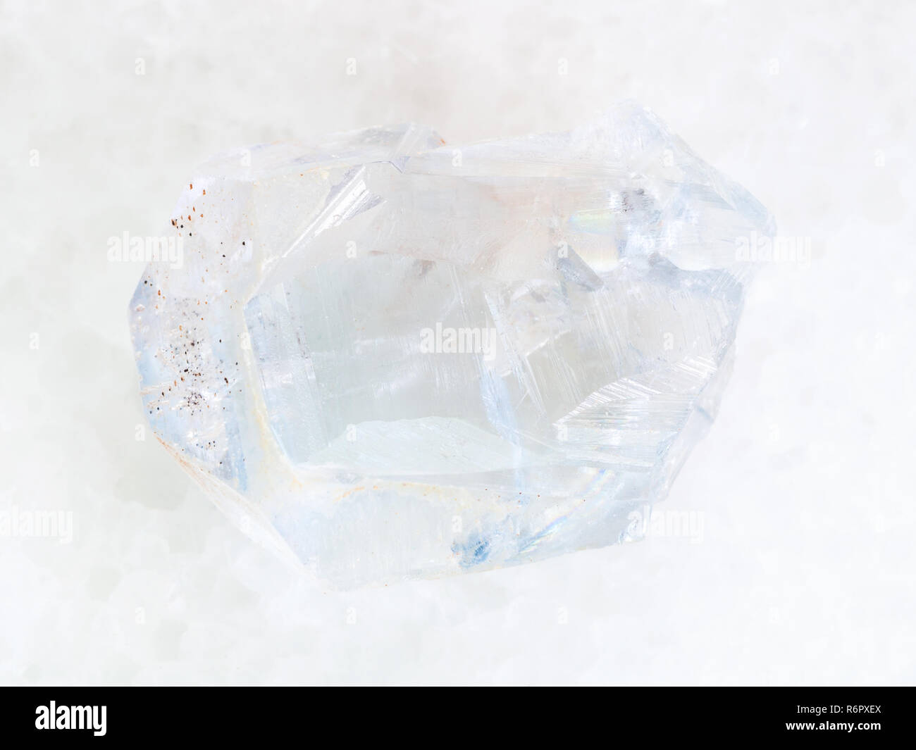 rough crystal of celestine stone on white marble - Stock Image