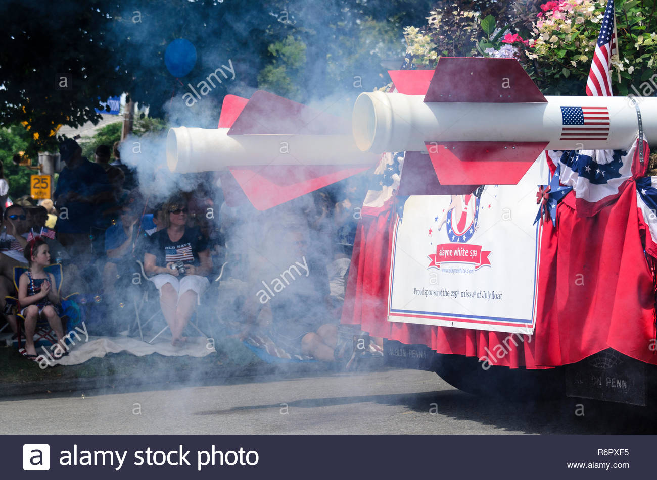 BRISTOL, RHODE ISLAND - JULY 4, 2011: Smoke from rocket-powered float at Fourth of July parade in Bristol, Rhode Island - Stock Image