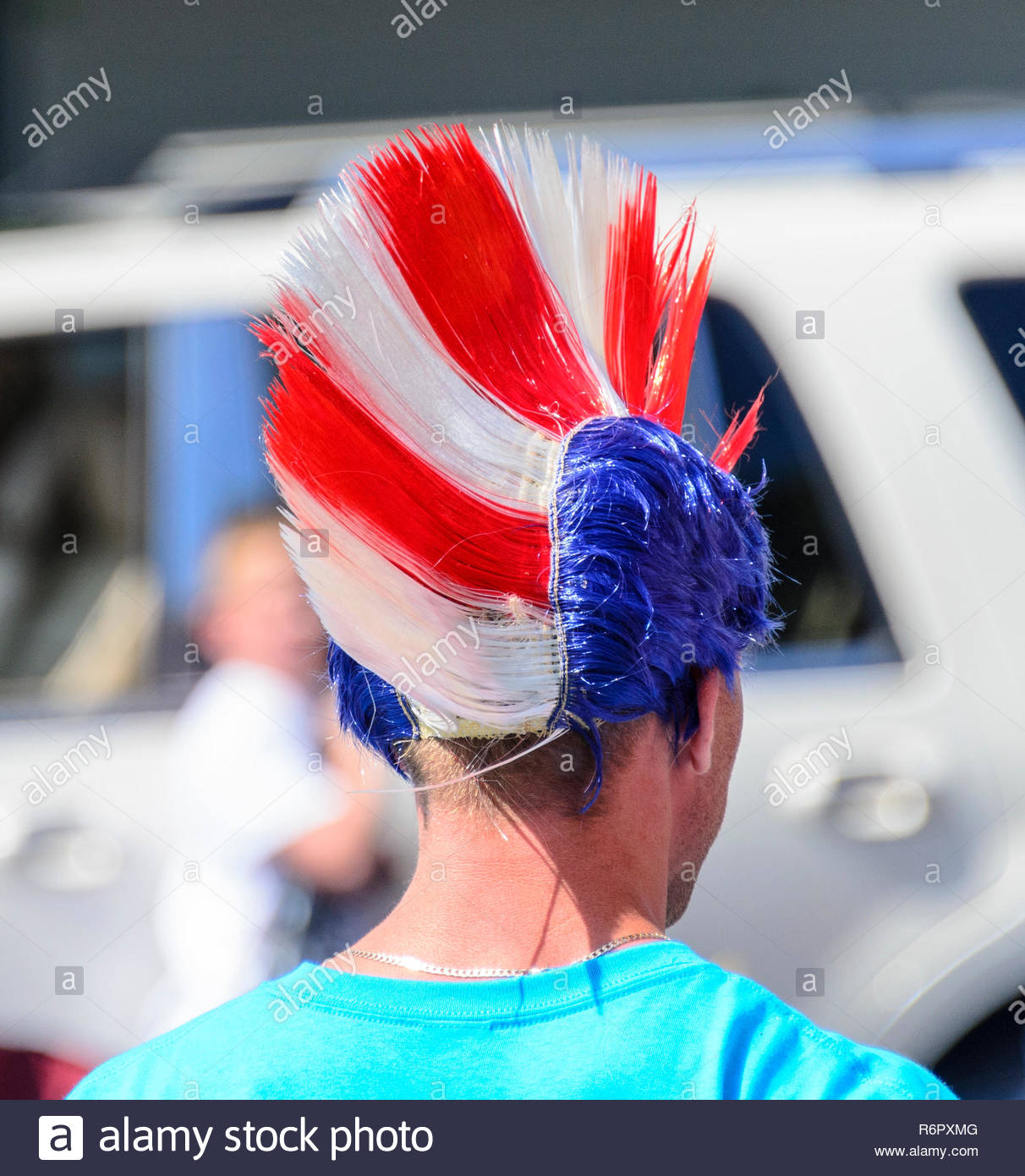 Bristol, Rhode Island, USA - July 4, 2011: Red, white and blue mohawk spectator headgear at parade - Stock Image