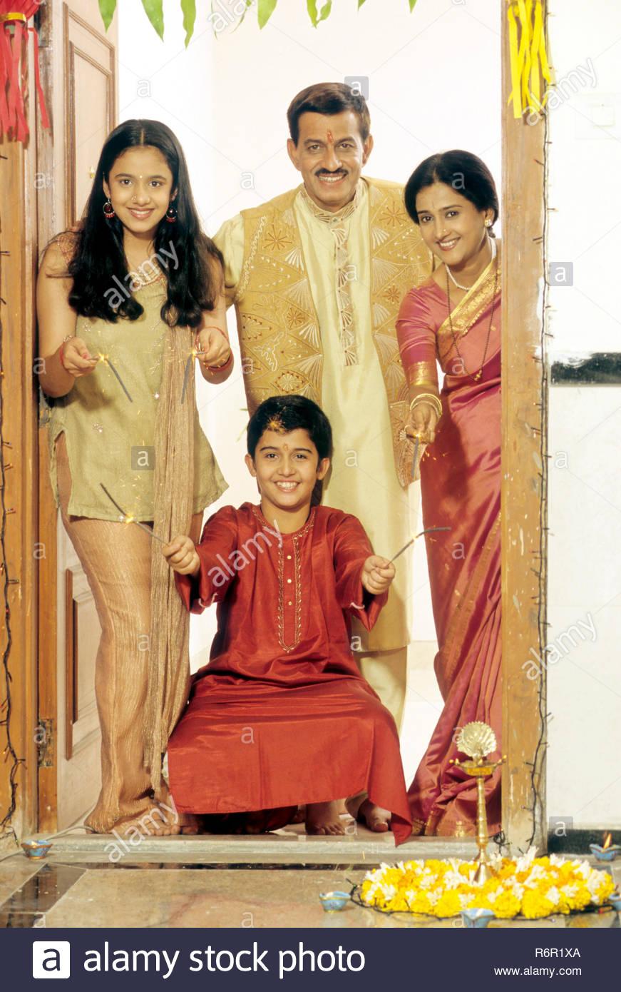 MAK-42403 : Family Celebrating Diwali deepawali Festival MR.NO.275.276.277.278 - Stock Image