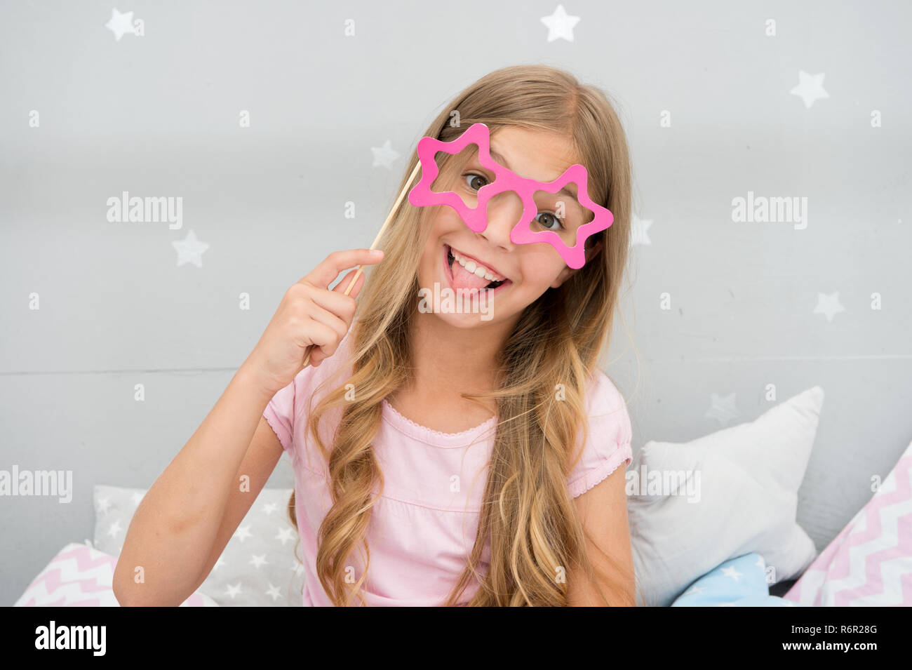 Playful Mood Girl With Long Blonde Curly Hair Posing With Photo