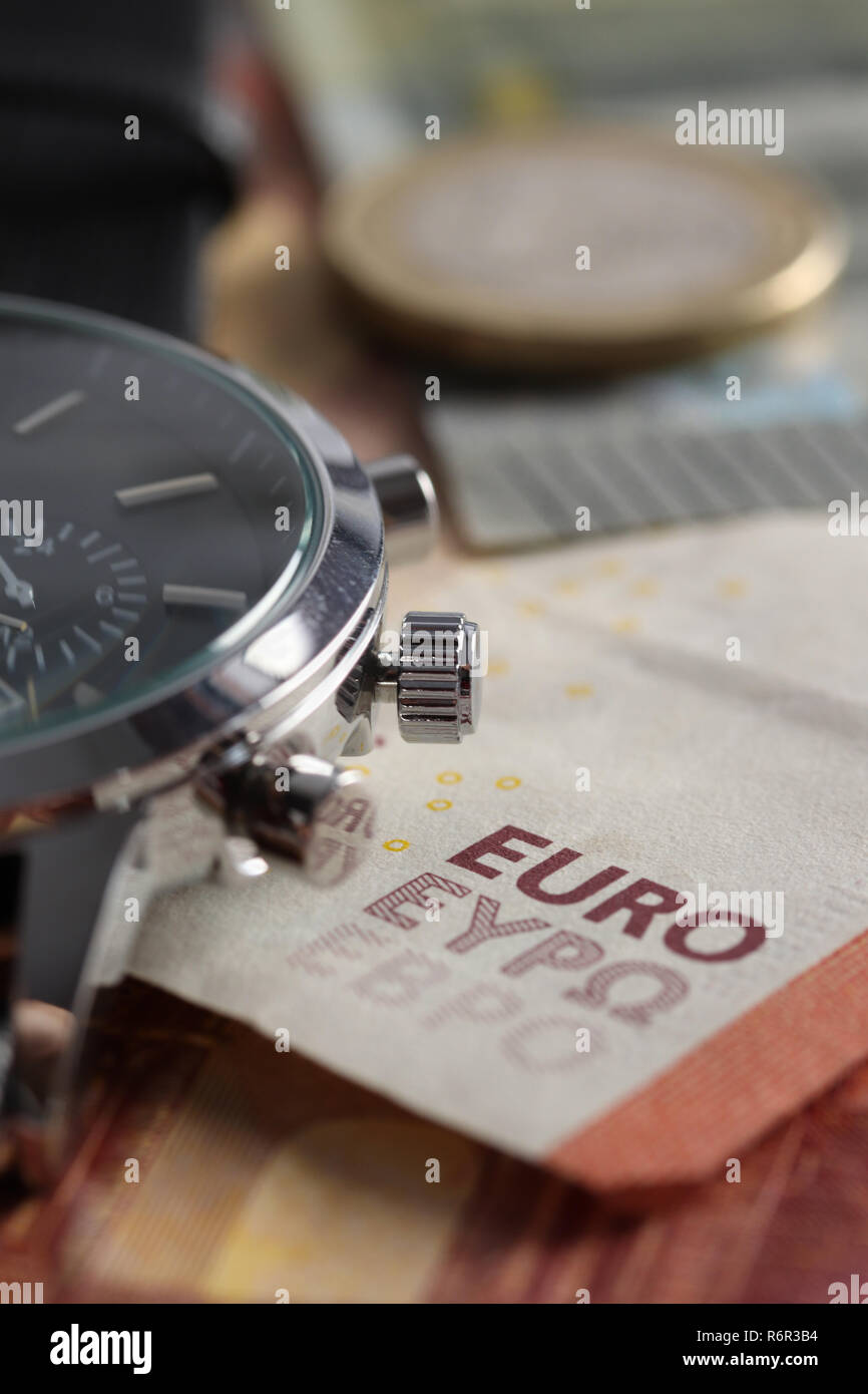 Money, Euro bills with wristwatches. Time is money. Brexit - Stock Image