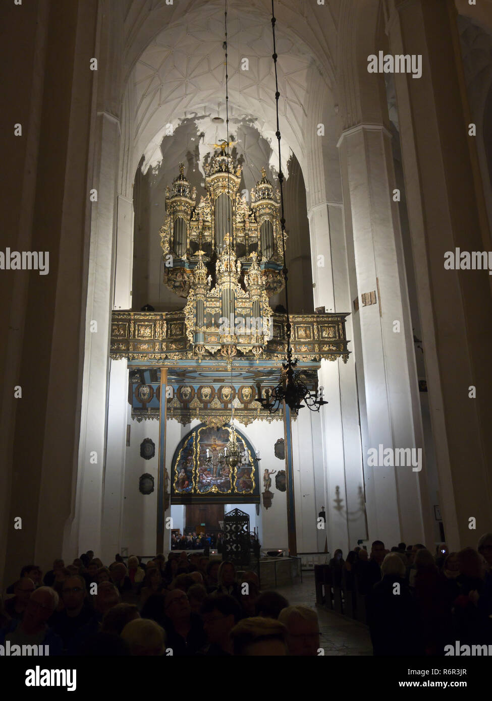 The grand baroque organ in the St Mary´s church in the old town centre of Gdansk Poland, flooded with light during an organ recital - Stock Image