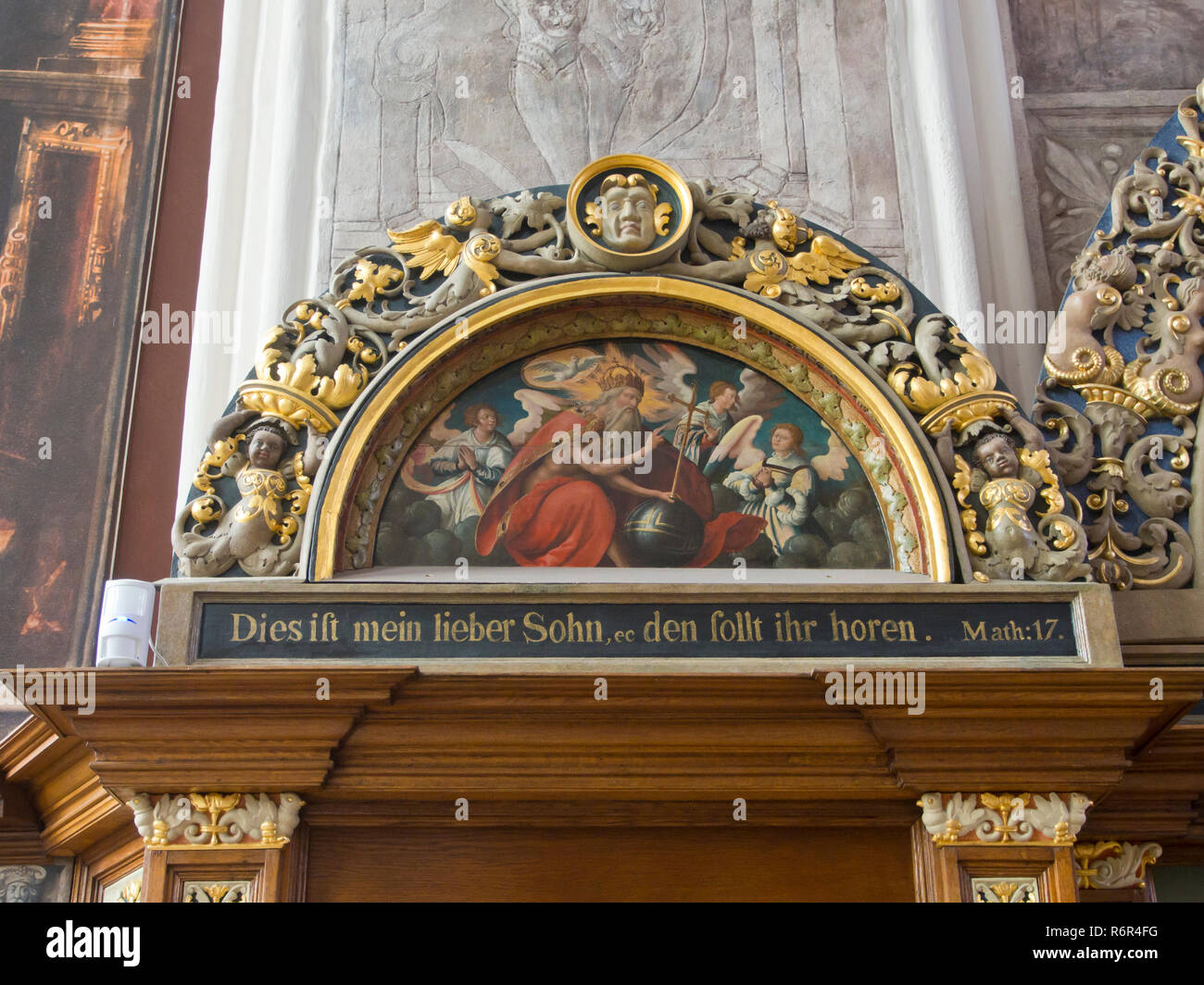 Artus Court museum in Gdansk Poland, a must see for tourists, interior view in the hall with painted and carved portal and New Testament quotation - Stock Image