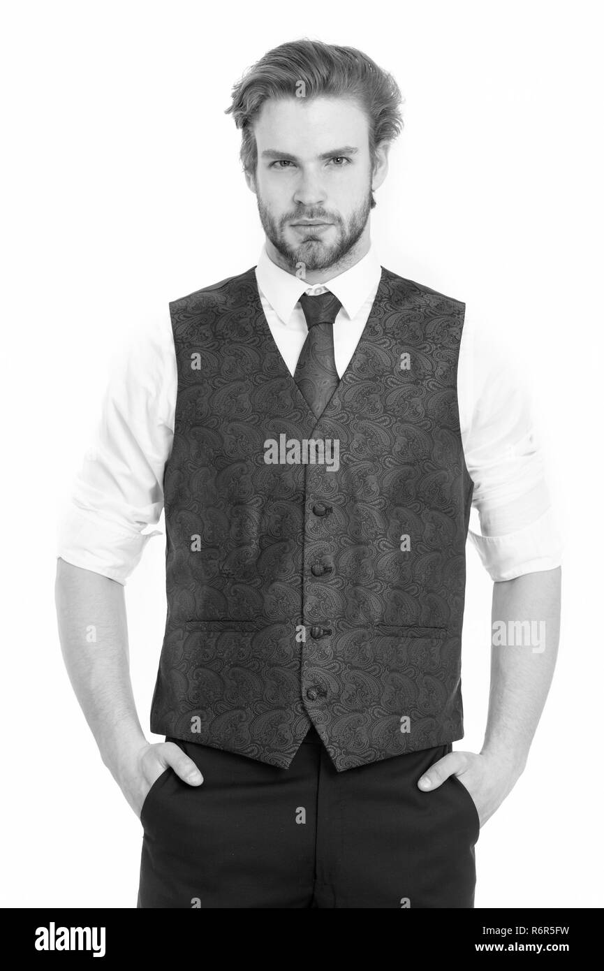 An elegant bearded business man in waistcoat isolated on white background - Stock Image