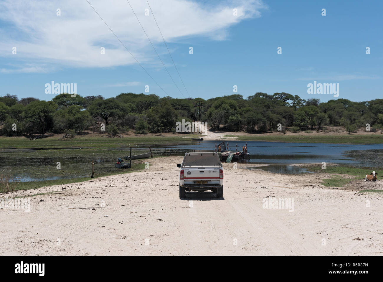 crossing the boteti river by car and passenger ferry in makgadikgadi pans national park, botswana - Stock Image