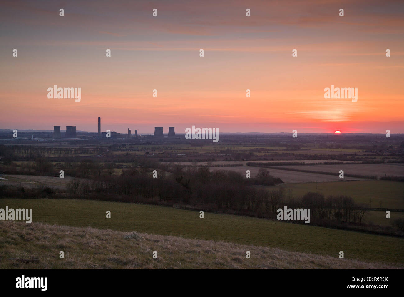 Didcot Power Station at sunset photographed from Round Hill  Wittenham Clumps, photographed before the demolition of the three Southern cooling towers - Stock Image