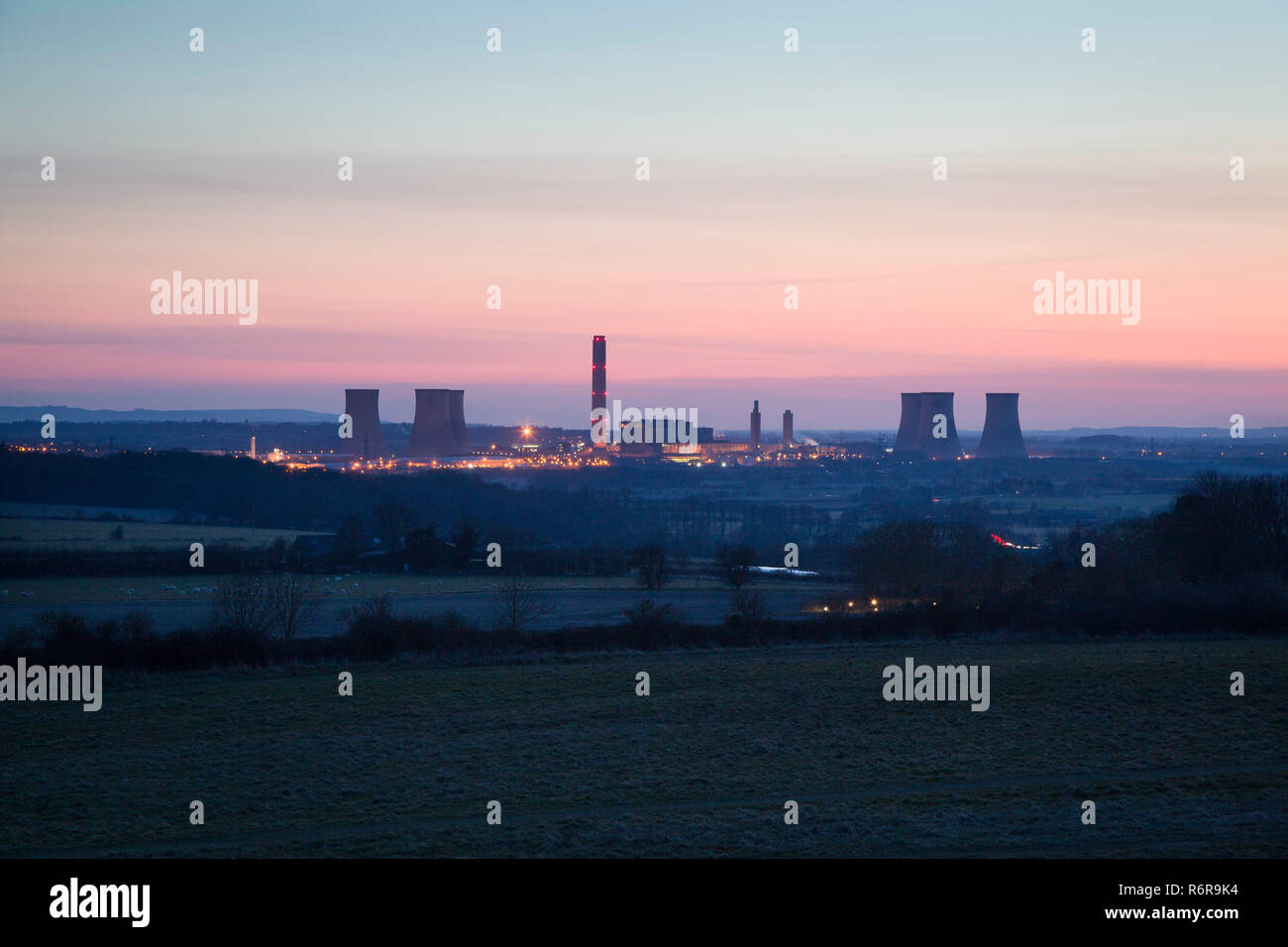 Didcot Power Station at  dusk photographed from Round Hill, Wittenham Clumps, photographed before the demolition of the three Southern cooling towers - Stock Image