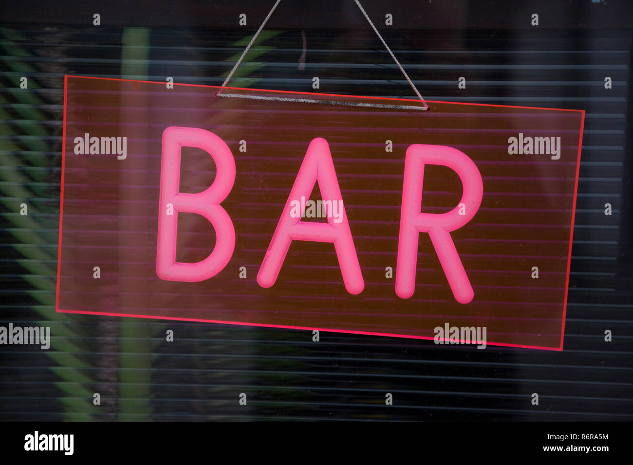 A colourful neon sign for a bar in Skibbereen, West Cork, Eire, the Republic of Ireland - Stock Image