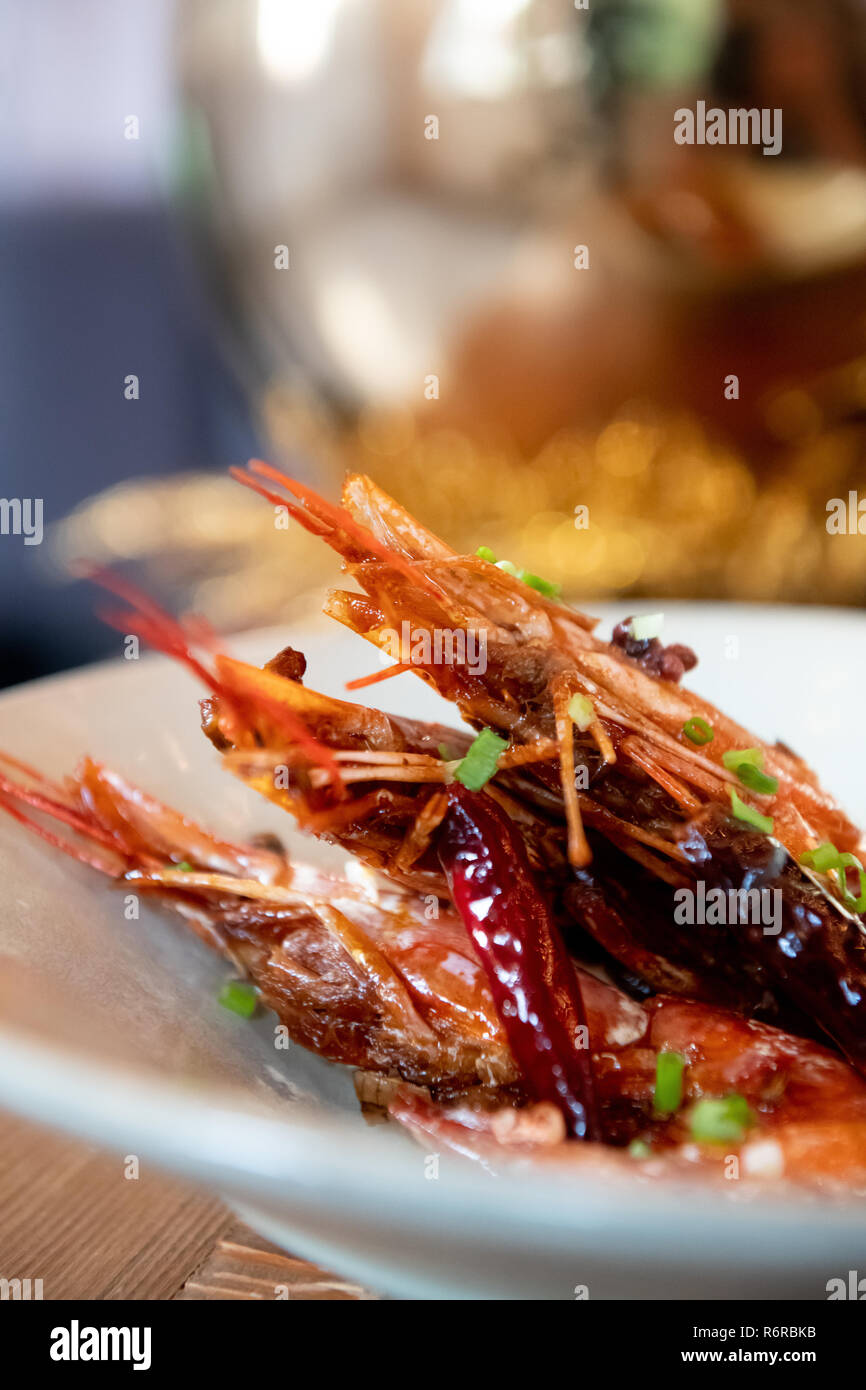 Three Prawns on White Plate Cooked Delicious Closeup Asian Cuisine Stock Photo