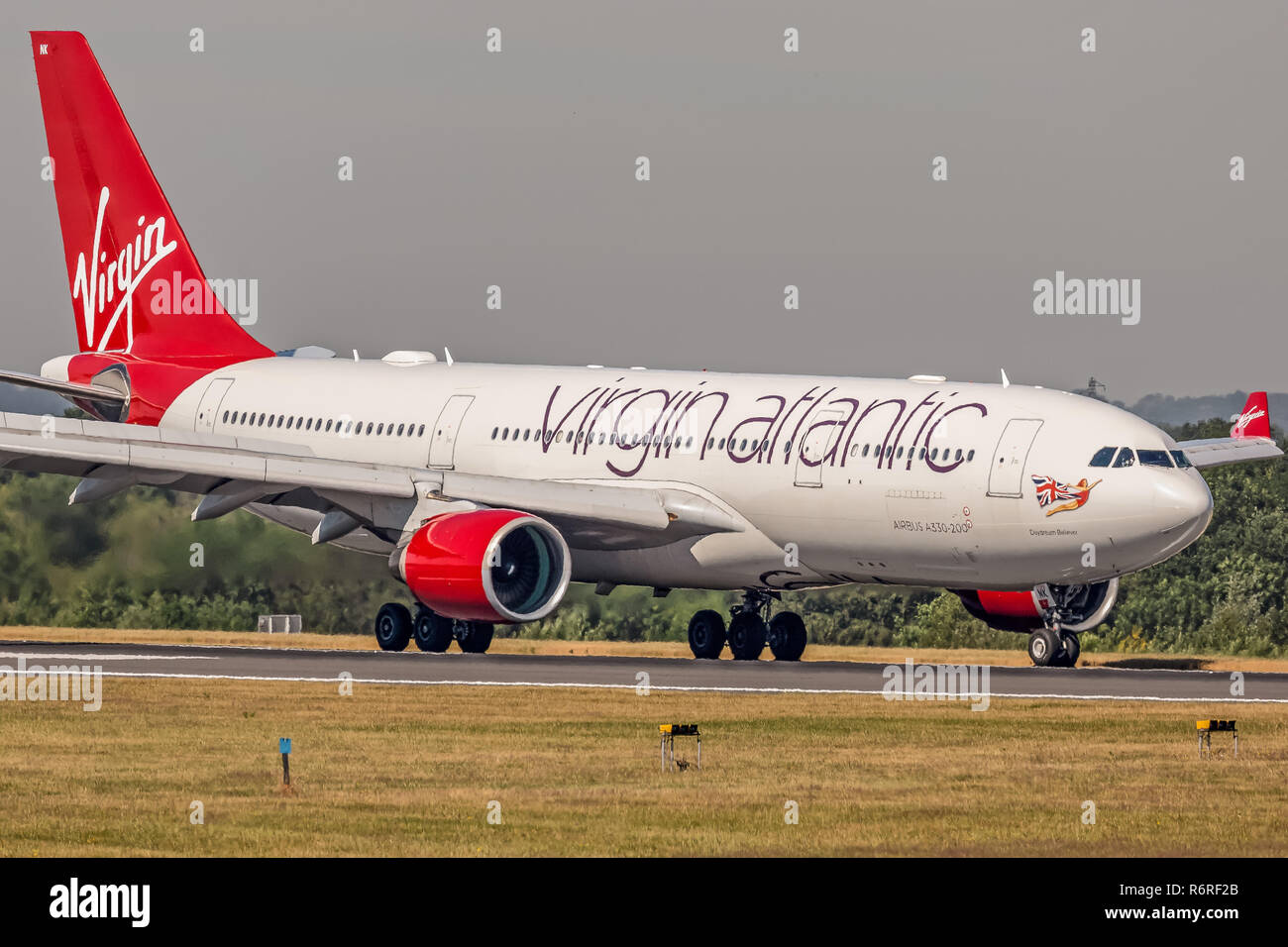 A Virgin Atlantic Airways Airbus A330, registration G-VMNK, taxying back to the terminal at Manchester Airport in England after landing. - Stock Image