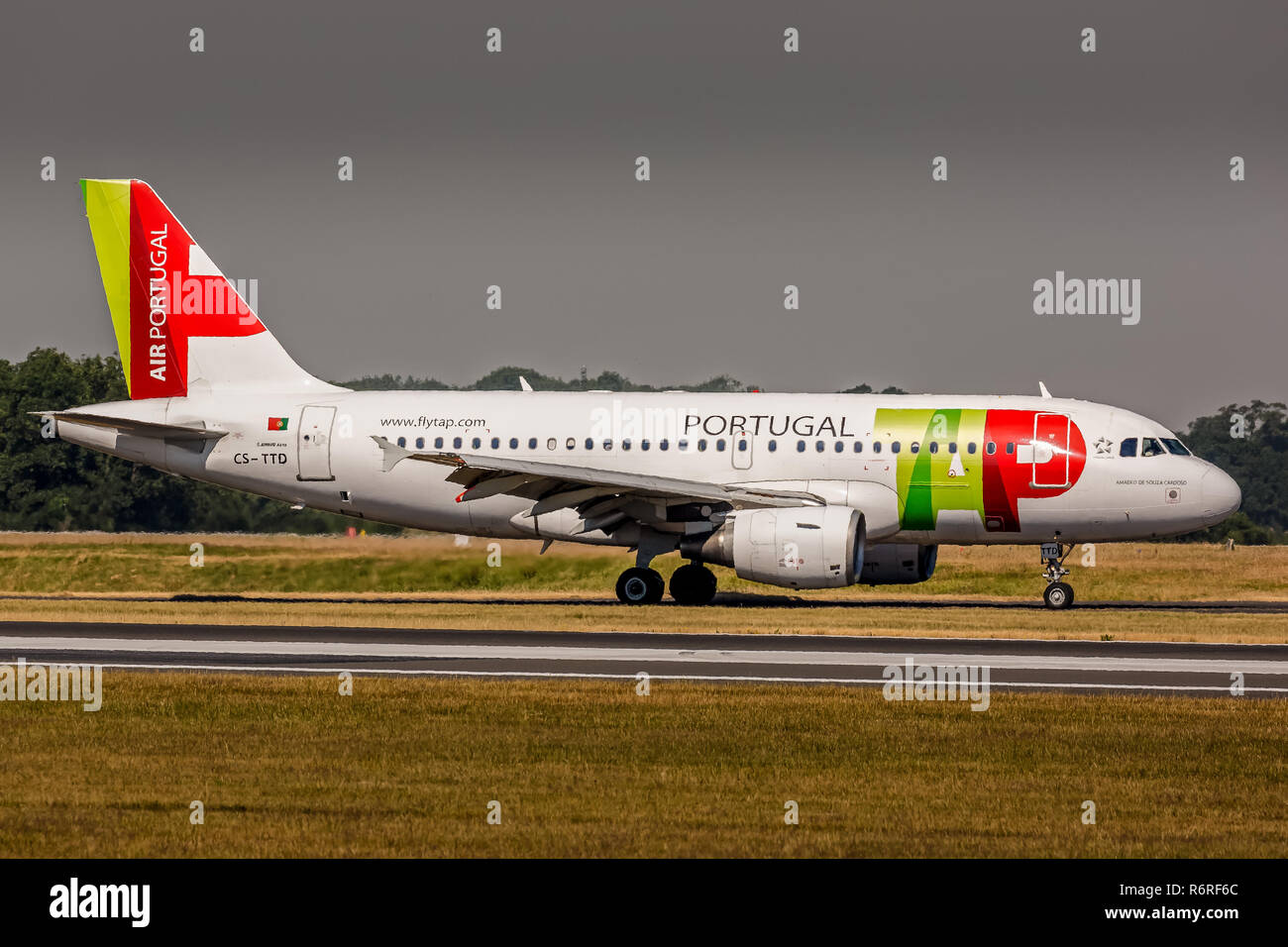 An Air Portugal TAP Airbus A319, registration CS-TTD, taxying back to the terminal At Manchester Airport in England after landing. - Stock Image