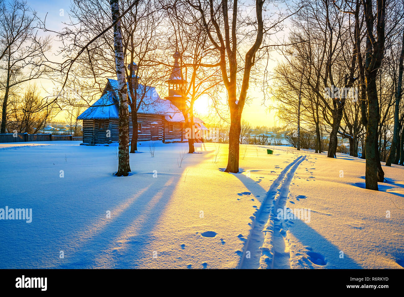 Russian church in winter forest Stock Photo