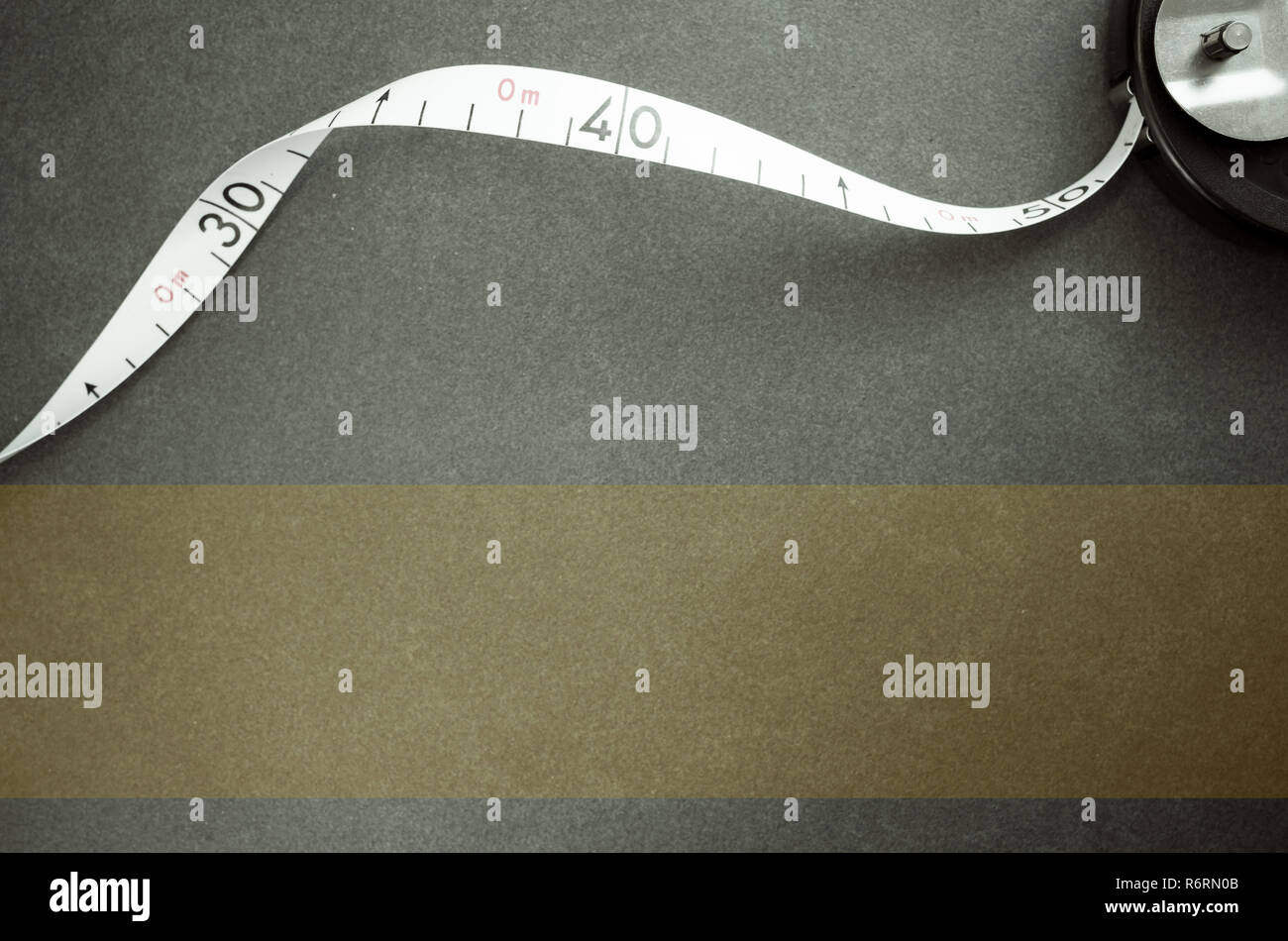 industrial metric measuring tape on a stone surface - top view Stock Photo