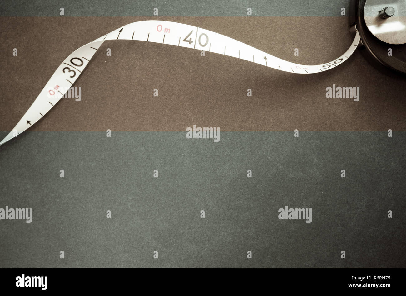 industrial metric flexible ruler on a stone surface - rectangular copy space - Stock Image