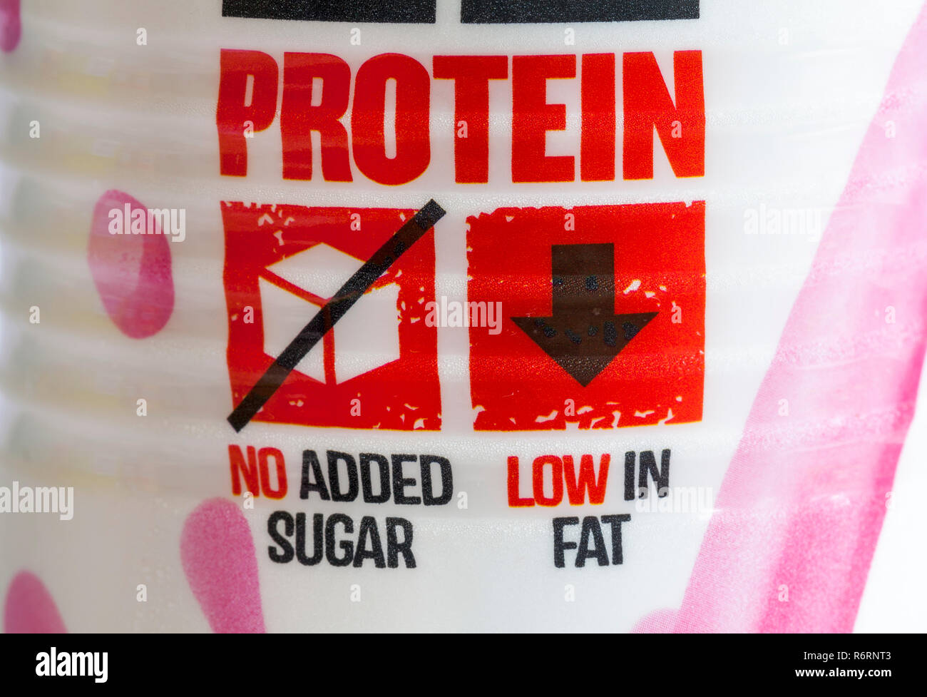 Protein, no added sugar, low in fat - detail on bottle of uFIT deliciously protein packed Strawberry flavour high protein milkshake - Stock Image